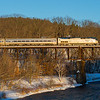 Amtrak's Vermonter in the last light of the day on the Millers Falls High Bridge.