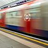 A Victoria Line train blurs through the Pimlico tube station.
