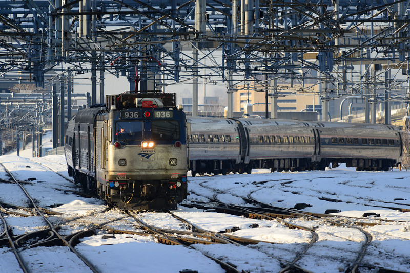 Amtrak AEM-7AC 936 brings train 66 into South Station in Boston.