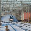 Running from a cloud of snow, Amtrak Regional 165 passes through Readville.